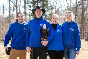 Team w Eagle statue